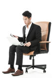 Businessman multitasking Stock Images