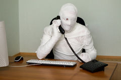 Businessman mummy with telephon Stock Photography