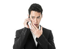 Businessman murmuring into phone Stock Images