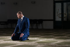 Businessman Muslim Praying In Mosque Royalty Free Stock Photo