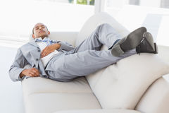 Businessman napping on the couch Royalty Free Stock Images