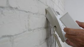 Businessman Near Interior Office Wall Dialing a Number Try to Make a Phone Call. stock footage