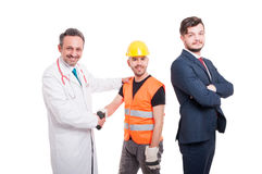Businessman near medic and engineer offering handshake Stock Photos