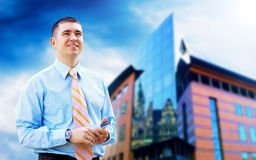 Businessman near the modern buildings Royalty Free Stock Image