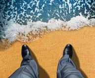 Businessman near the sea Stock Photos