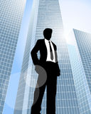 Businessman near skyscrapers Royalty Free Stock Photography