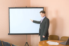 Businessman near the white screen Royalty Free Stock Photo