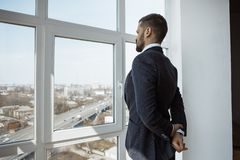 Businessman Near Window in Office. stock images