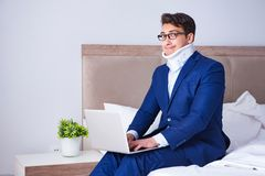 The businessman with neck injury working from home. Businessman with neck injury working from home Stock Photography