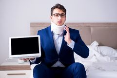The businessman with neck injury working from home. Businessman with neck injury working from home Stock Image