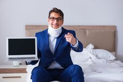 The businessman with neck injury working from home. Businessman with neck injury working from home Royalty Free Stock Photos