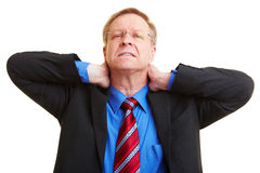 Businessman with neck pain Stock Images