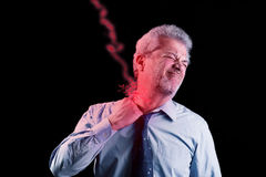 Businessman with neck pain like lightnings Royalty Free Stock Images