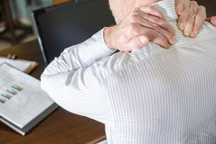 Businessman with neck pain Stock Photo