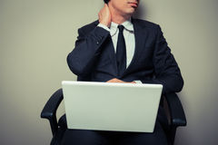 Businessman with neck pain Stock Image