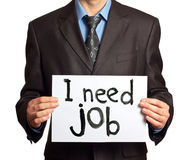Businessman a need job. Businessman holding sign I need job Stock Images