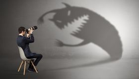 Businessman negotiate with a monster shadow royalty free stock photos