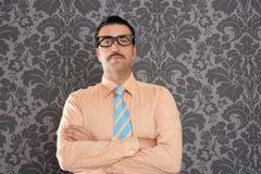 Businessman nerd portrait retro glasses wallpaper. Businessman nerd portrait with retro glasses over wallpaper background Stock Images