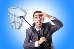 Businessman with net  Stock Images