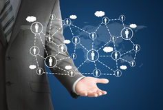 Businessman and network of contacts on hand Stock Photos