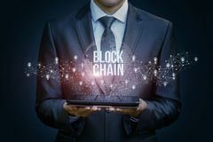 Businessman in the network shows the block chain . Stock Photo