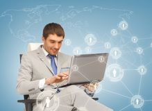 Businessman networking with laptop Stock Photography