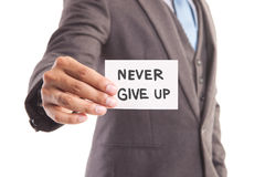 Businessman with never give up message Stock Photography