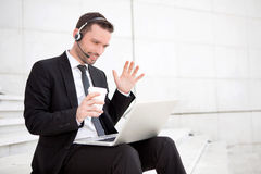 Businessman never stops working ! Stock Photography