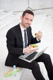 Businessman never stops working ! Stock Image