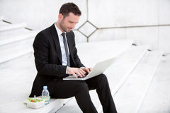 Businessman never stops working ! Stock Images