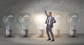 The businessman in new idea concept with light bulb. Businessman in new idea concept with light bulb Royalty Free Stock Photos