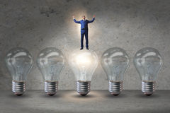 The businessman in new idea concept with light bulb. Businessman in new idea concept with light bulb Royalty Free Stock Photo