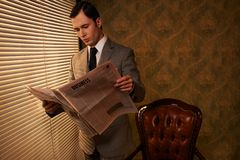 Businessman with a newspaper Royalty Free Stock Photography
