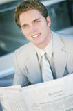 Businessman and newspaper Royalty Free Stock Photo