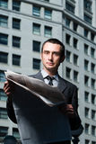 Businessman with newspaper Royalty Free Stock Images