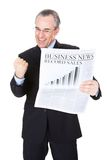 Businessman with newspaper Royalty Free Stock Photo