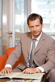 Businessman with newspaper, portrait Royalty Free Stock Photography