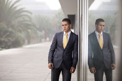 Businessman next to the office door Royalty Free Stock Image