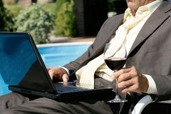 Businessman next to the swimming pool Royalty Free Stock Photo