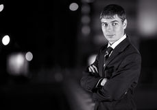 Businessman and at night city Royalty Free Stock Images