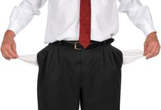 Businessman with no money. Businessman in blank pants and a white shirt pulling out empty pockets to show he is broke stock photo