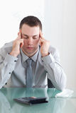 Businessman not happy with his calculations Royalty Free Stock Photography