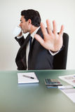 A businessman not willing to be disturbed Stock Images