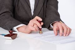 Signing testament. Businessman notarize testament at notary public office stock image