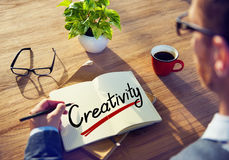 Businessman with Note About Creativity Concepts Stock Photos