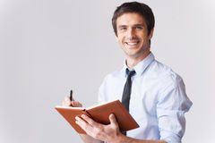 Businessman with note pad. Stock Images