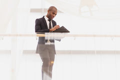 Businessman with note pad. Royalty Free Stock Photography