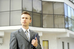 Businessman with a notebook. Businessman is thinking about things that he needs to be done Stock Photos