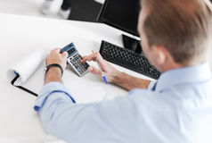 Businessman with notebook and calculator Stock Photo