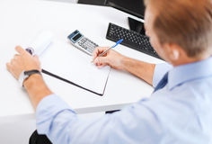Businessman with notebook and calculator Royalty Free Stock Photography